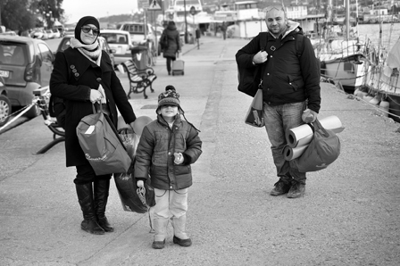 Ammar and his family on their way to the Athens Ferry, Lesbos, Greece. Photo: Emily Scott Pottruck