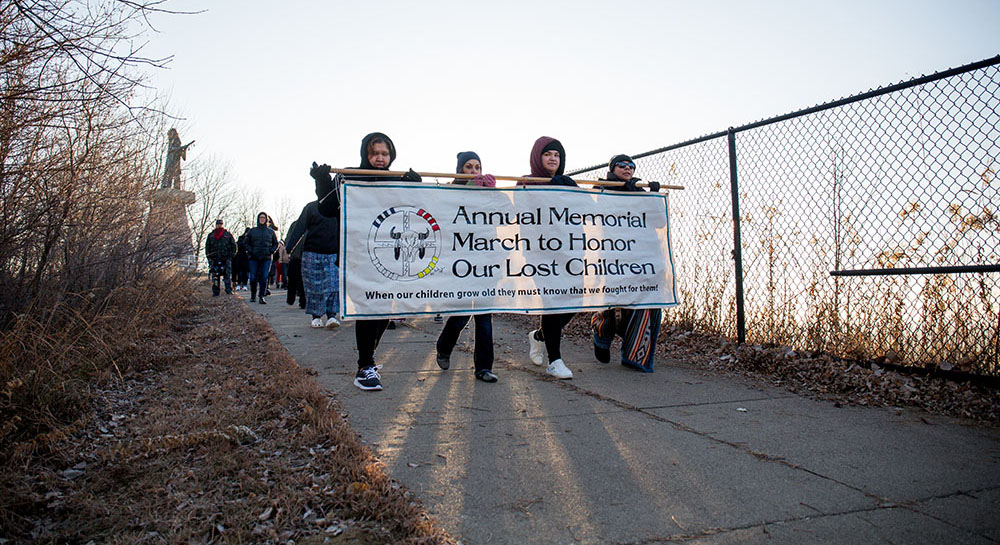 Memorial March to Honor Lost Children banner
